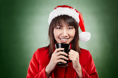 Christmas girl with cup of drink Stock Images