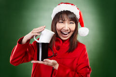 Christmas girl with cup of drink Royalty Free Stock Photos