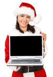 Christmas girl displaying a laptop Stock Photo