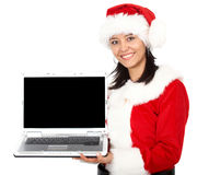 Christmas girl displaying a laptop Royalty Free Stock Photography