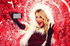 Christmas girl doing selfie Royalty Free Stock Images