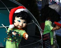 Christmas Girl doll in an outdoor display Royalty Free Stock Images