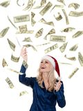 Christmas girl with dollars Stock Images