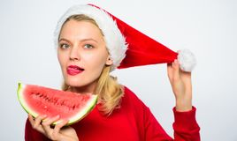 Christmas girl eat watermelon. Exotic winter holiday. Celebrate new year summer. Girl wear santa hat eat slice. Watermelon white background. Summer treats on royalty free stock images