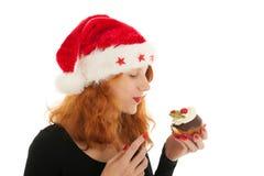 Christmas girl eating cake Stock Photography