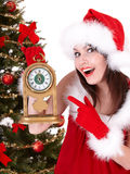 Christmas girl and fir tree with alarm clock. Royalty Free Stock Images