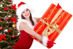 Christmas girl and fir tree with red gift box. Stock Photo