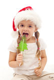 Christmas girl with fir tree shaped candy Royalty Free Stock Image