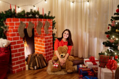 In Christmas girl on the floor in the room with the decor, the t Stock Images