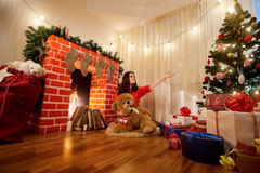 In Christmas girl on the floor in the room with the decor, the t Stock Photo