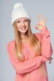 Christmas girl gesturing OK sign Royalty Free Stock Image