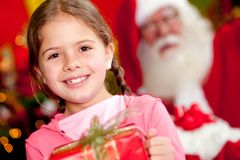 Christmas girl with a gift Stock Photography
