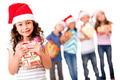 Christmas girl with a gift Royalty Free Stock Photos