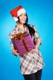 Christmas girl with a gift box Stock Image