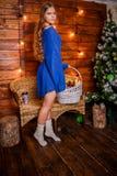 Christmas girl with gift. Girl in Christmas decorations with a gift with a good Christmas mood Stock Image
