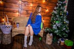Christmas girl with gift. Girl in Christmas decorations with a gift with a good Christmas mood Royalty Free Stock Photos