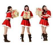 Christmas girl with gifts Stock Images