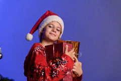 Christmas girl with gifts Royalty Free Stock Photos