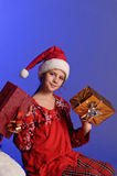Christmas girl with gifts Stock Photos
