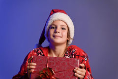 Christmas girl with gifts. Girl teenager in santa hat with Christmas gifts royalty free stock photos