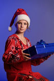 Christmas girl with gifts Stock Image