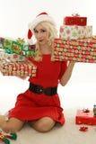Christmas girl with gifts stock photos