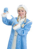 Christmas girl gifts keys to the new home. Smiling girl dressed in traditional russian christmas costume of Snegurochka (Snow Maiden) gifts keys to the new home Stock Image