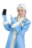 Christmas girl gifts mobile. Smiling girl dressed in traditional russian christmas costume of Snegurochka (Snow Maiden) gifts mobile phone, isolated on white Royalty Free Stock Photography