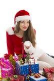 Christmas girl, gifts and snow Stock Image