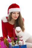 Christmas girl, gifts and snow Royalty Free Stock Image