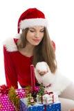 Christmas girl, gifts and snow Royalty Free Stock Image