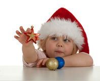 Christmas girl with glass balls Stock Images