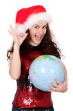 Christmas girl with globe Stock Image