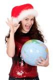 Christmas girl with globe Stock Image