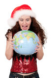 Christmas girl with globe Stock Photography
