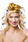 Christmas girl with golden bow Royalty Free Stock Photos