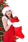 Christmas girl in hat, sock, tree with gift box. Royalty Free Stock Image