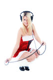 Christmas girl in headphones Stock Photography