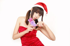 Christmas girl with her gift Stock Photos