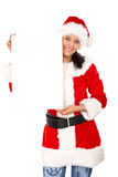 Christmas girl holding add Royalty Free Stock Image