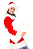 Christmas girl holding add Royalty Free Stock Images