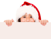 Christmas girl holding a banner Stock Photos