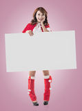 Christmas girl holding a blank board Royalty Free Stock Photography