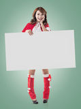 Christmas girl holding a blank board Royalty Free Stock Images