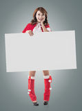 Christmas girl holding a blank board Royalty Free Stock Photos