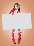 Christmas girl holding a blank board Stock Image