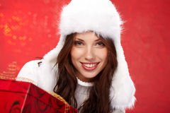 Christmas girl  holding a gift Royalty Free Stock Photos