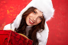 Christmas girl  holding a gift Royalty Free Stock Photography