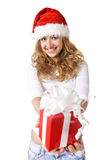 Christmas girl holding gift Stock Photos
