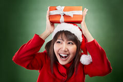 Christmas girl holding gift Stock Photography